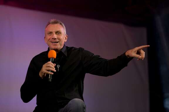 Former San Francisco 49ers quarterback Joe Montana speaks as he is interviewed on stage during an NFL fan rally in Trafalgar Square, London, Saturday, Oct. 26, 2013.  The San Francisco 49ers are due to play the the Jacksonville Jaguars at Wembley stadium in London on Sunday, Oct. 27 in a regular season NFL game.  (AP Photo/Matt Dunham)