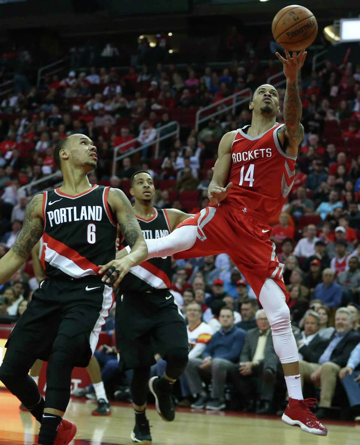Houston Rockets guard Gerald Green (14) attempts for the basket while Portland Trail Blazers guard Shabazz Napier (6) looks on during the second quarter of the NBA game at Toyota Center on Wednesday, Jan. 10, 2018, in Houston. ( Yi-Chin Lee / Houston Chronicle )