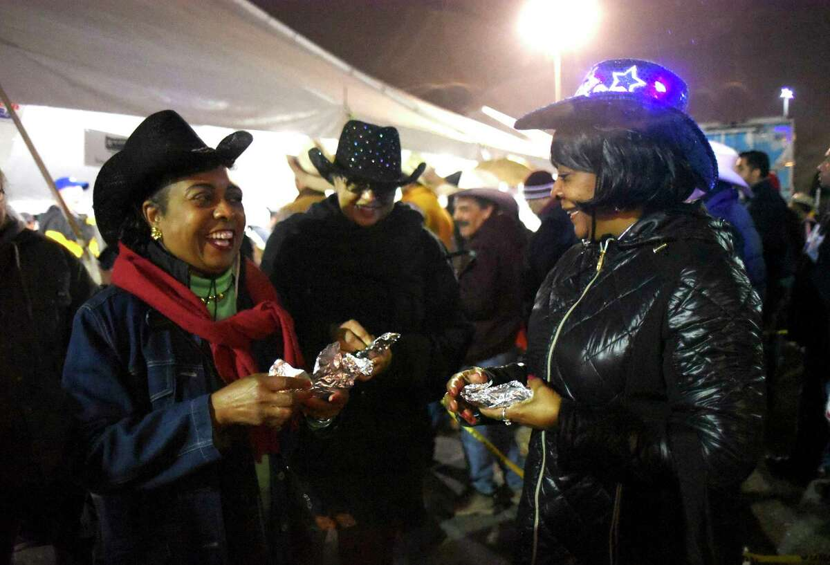 Joanne Short, left, Jennifer Davis and Deborah Sullivan enjoy sausage and egg tacos.during the annual Cowboy Breakfast to kick off the San Antonio Rodeo season at Cowboys Dance Hall on Friday morning, Jan. 26, 2018. Thousands of people received tacos, biscuits, milk and coffee.