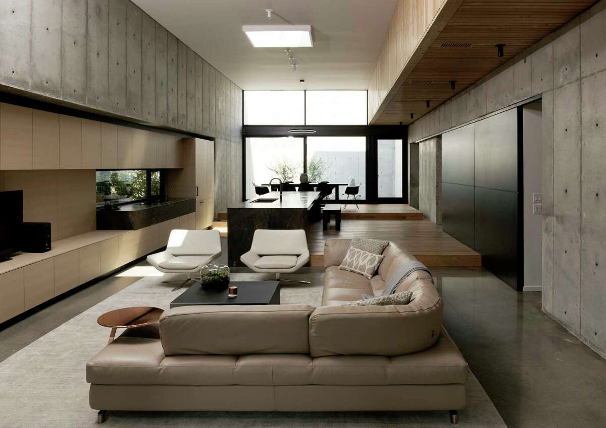 The main living area in the Heights home of architects Vivi and Christopher Robertson is 50 feet long and 17 feet wide.