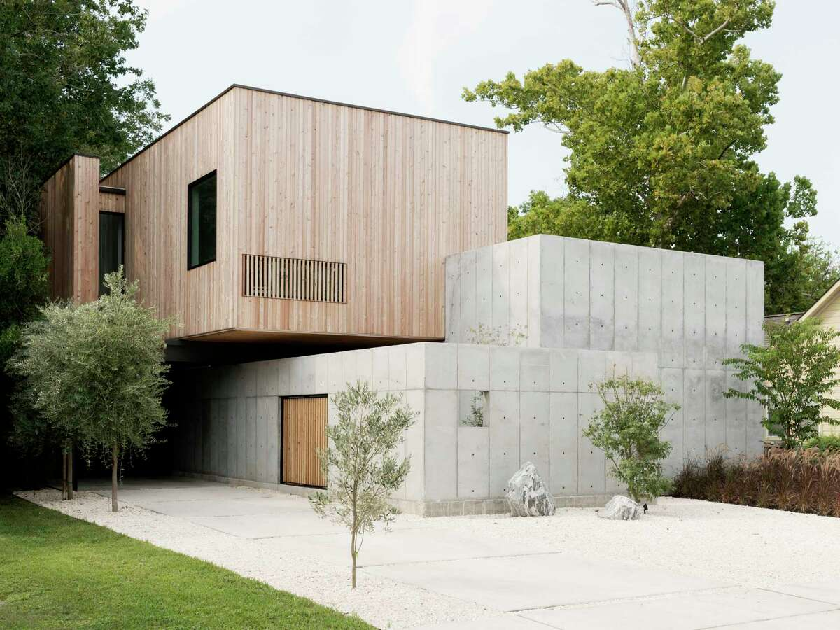 The Robertsons designed their home to be constructed with organic materials - 16-foot concrete walls paired with Siberian larch wood, which will turn gray with age.