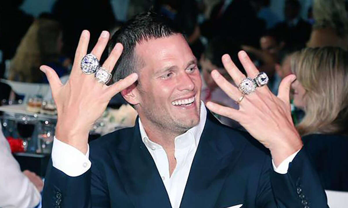 PHOTOS: A look at each Super Bowl ring over the years New England Patriots quarterback Tom Brady shows off some of his Super Bowl rings at a team celebration. Tom Brady has the most Super Bowl rings as a player with six, which have gotten progressively bigger and more expensive through the years. Browse through the photos above for a look at each Super Bowl ring through the years ...