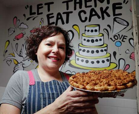Fluff Bake Bar owner pastry chef Rebecca Masson poses for a portrait with an apple pie Wednesday, Nov. 11, 2015, in Houston.