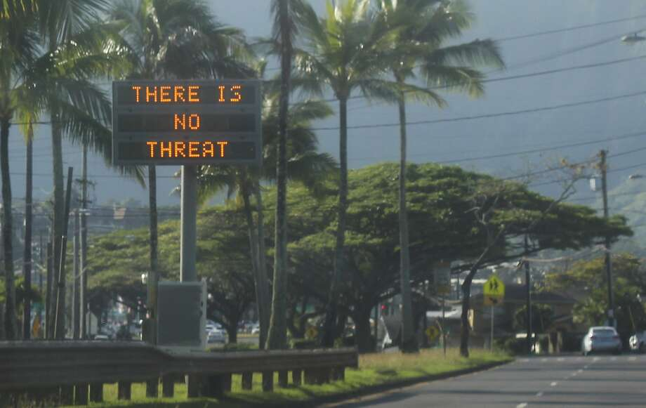 """This Saturday, Jan. 13, 2018, photo provided by Jhune Liwanag shows a highway median sign broadcasting a message of """"There is no threat"""" in Kaneohe, Hawaii. State emergency officials mistakenly sent out an emergency alert warning of an imminent missile strike, sending islanders into a panic. (Jhune Liwanag via The AP) Photo: Jhune Liwanag, Associated Press"""