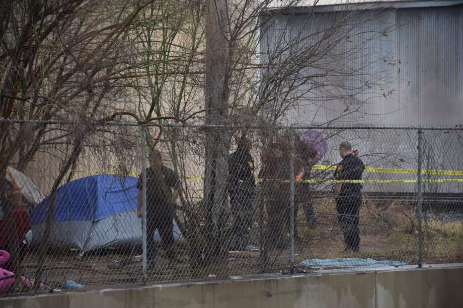 Police on Friday found the body of a man who was fatally shot in the chest at a homeless camp behind a fire station on the East Side. Photo: Caleb Downs / San Antonio Express-News