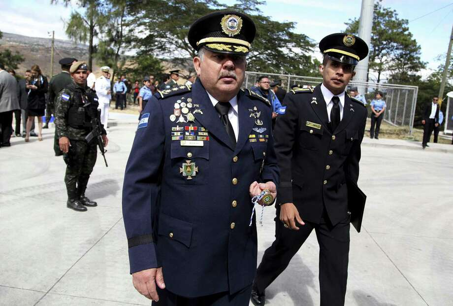New Police Chief Jose David Aguilar Moran (center) reportedly helped deliver a ton of cocaine. Photo: Fernando Antonio / Fernando Antonio / Associated Press / Copyright 2018 The Associated Press. All rights reserved.