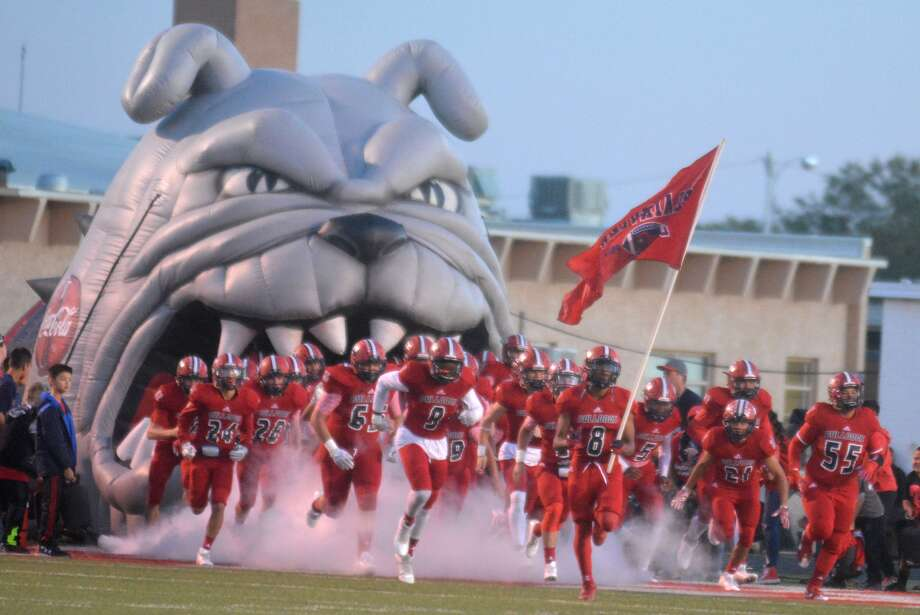 The Plainview Bulldogs take the field for a football game this past season. With the UIL realignment to be announced Thursday, Bulldog coach Ryan Rhoades says he foresees changes to Plainview's football district. Photo: Skip Leon/Plainview Herald