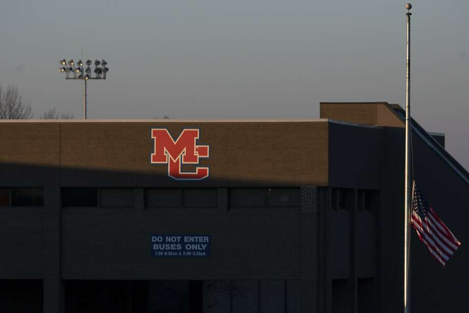 A flag at Marshall County High School in Benton, Ky., flies at half-staff Thursday. The school reopened Friday, three days after a student went on a shooting spree and killed two teenagers. Photo: Ryan Hermens, Associated Press
