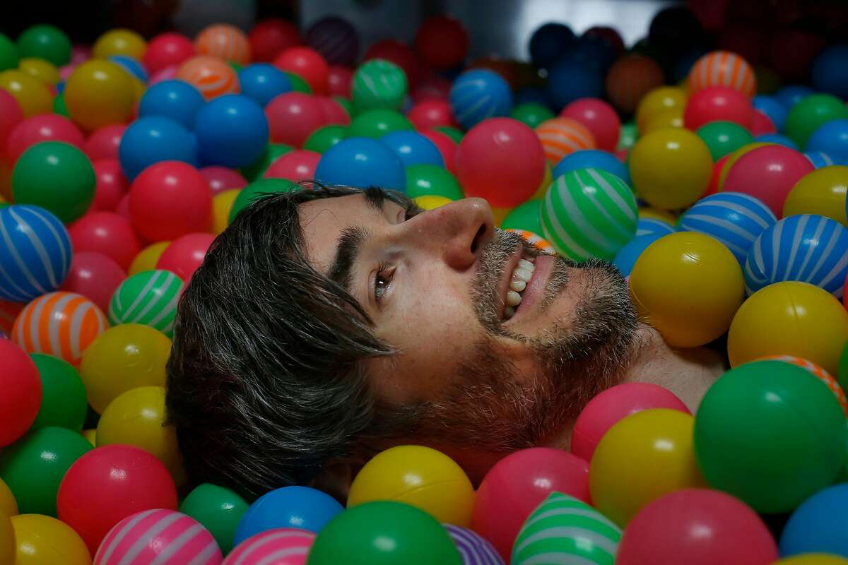Mike Callahan, CEO and co-founder AfterSchool, lays in a ball pit for a portrait in the office at After School on Thursday, January 25, 2018 in San Francisco, Calif.