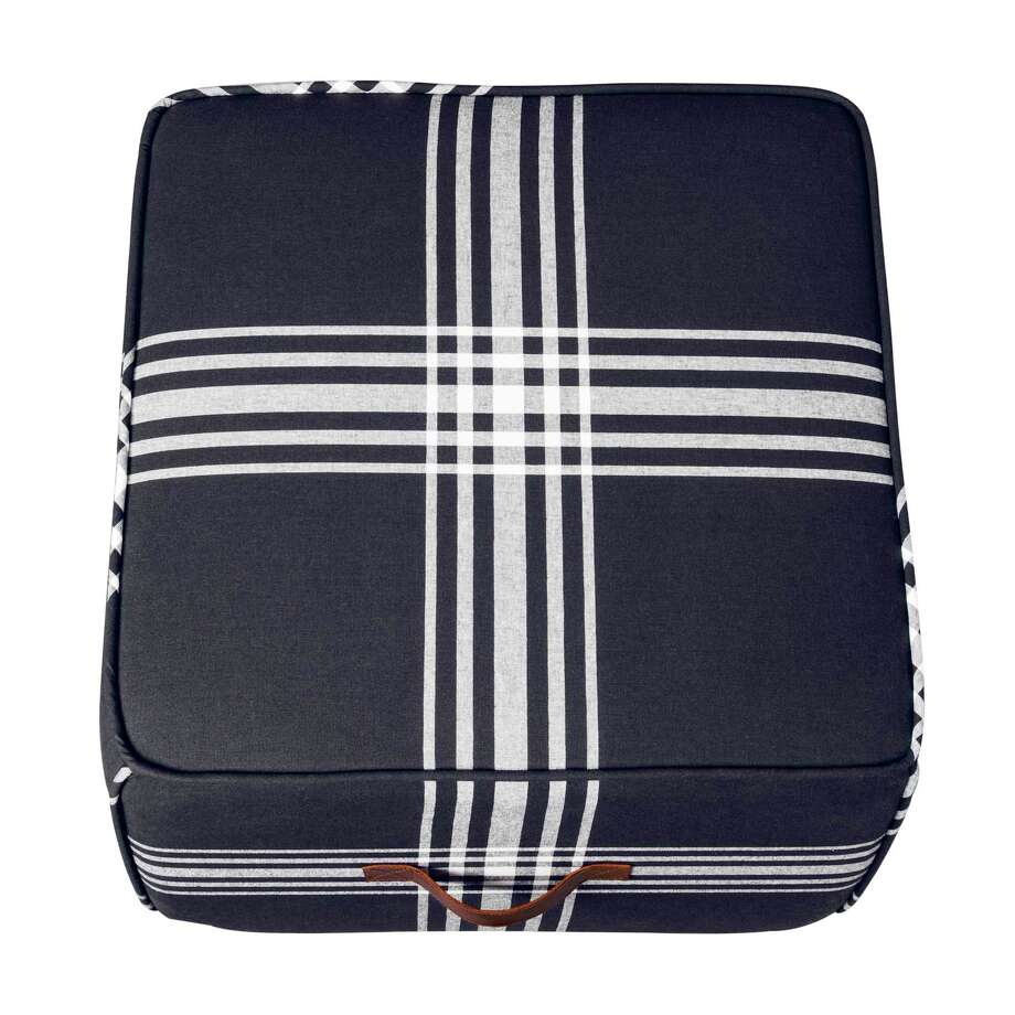 Right now I'm loving navy blue and this plaid pouf, $59.99, fits right in. Made of durable cotton fabric and with leather handles, this square piece can be used as seating or as a small coffee table. Photo: Target