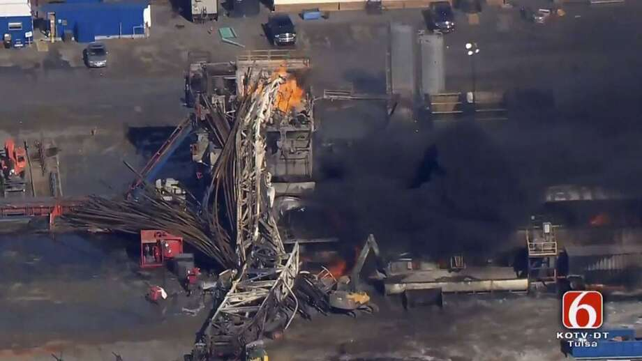 In this Jan. 22, 2018 photo provided from a frame grab by Tulsa's KOTV/NewsOn6.com, fires burn at an eastern Oklahoma drilling rig near Quinton, Okla. Five people workers were killed after a fiery explosion ripped through a drilling rig, sending plumes of black smoke into the air and leaving a derrick crumpled on the ground, emergency officials said. The U.S. Chemical Safety Board said it will launch a full investigation. Photo: Christina Goodvoice /Associated Press / KOTV/NewsOn6.com