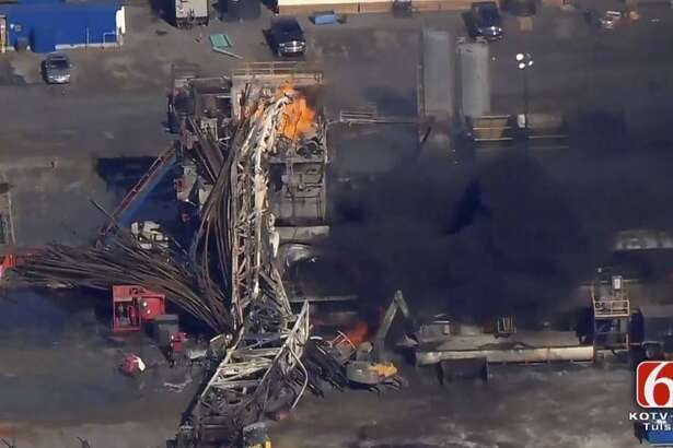 In this Jan. 22, 2018 photo provided from a frame grab by Tulsa's KOTV/NewsOn6.com, fires burn at an eastern Oklahoma drilling rig near Quinton, Okla. Five people workers were killed after a fiery explosion ripped through a drilling rig, sending plumes of black smoke into the air and leaving a derrick crumpled on the ground, emergency officials said. The U.S. Chemical Safety Board said it will launch a full investigation.
