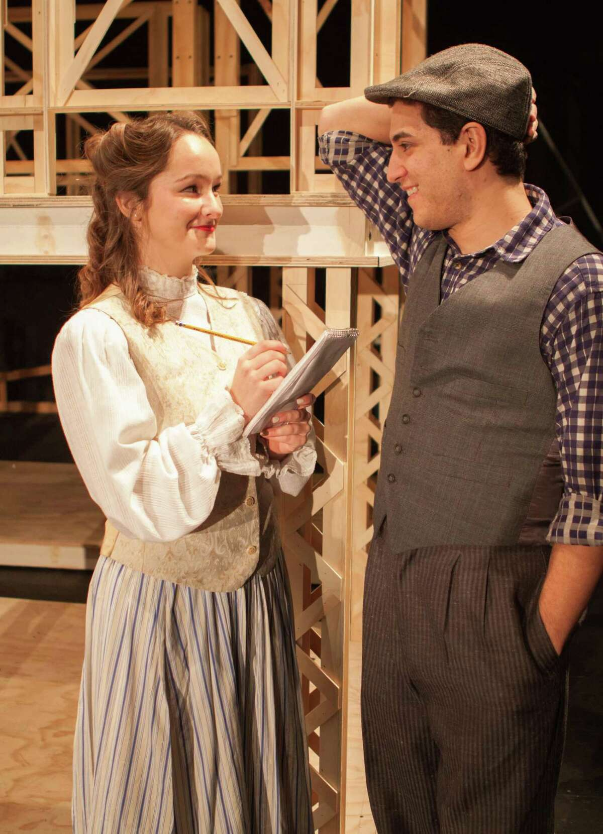 Newsie Jack Kelly (Chris Balestriere) tries to woo reporter Katherine Plumber (Jennifer Beveridge) in Curtain Call's production of