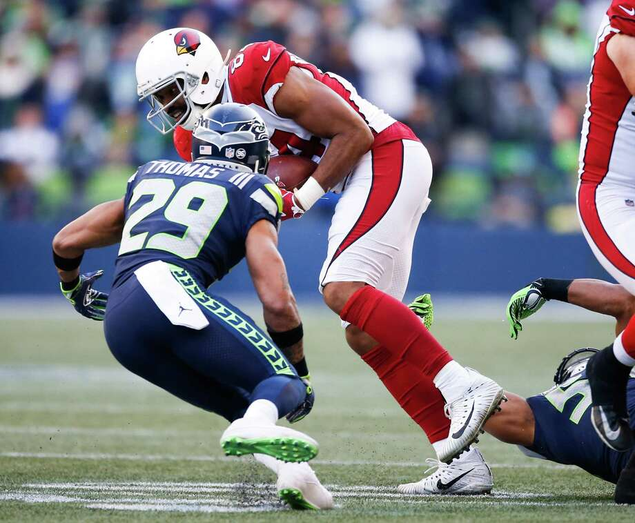 SEATTLE, WA - DECEMBER 31:  Tight end Jermaine Gresham #84 of the Arizona Cardinals tries to escape free safety Earl Thomas #29 of the Seattle Seahawks during the first half of the game at CenturyLink Field on December 31, 2017 in Seattle, Washington. Photo: Otto Greule Jr, Getty Images / 2017 Getty Images