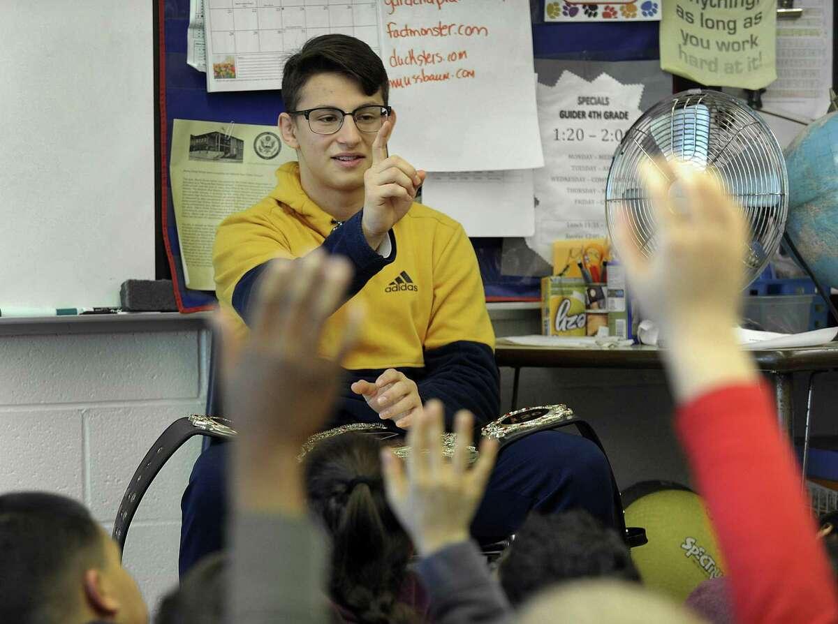 Danbury High School wrestler Jakob Camacho, 17, a senior at Danbury High School, spoke to forth-graders and answered their questions at Morris Street School in Danbury, Friday, January 26, 2018.