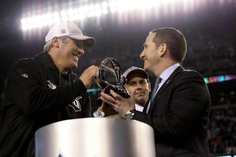 Philadelphia Eagles coach Doug Pederson, left, and Howie Roseman, right, the team's executive vice president of football operations, hold the NFC championship trophy after the Eagles' 38-7 win over the Minnesota Vikings in the NFC championship NFL football game Sunday, Jan. 21, 2018, in Philadelphia. (David Maialetti/The Philadelphia Inquirer via AP) Photo: David Maialetti, MBI / The Philadelphia Inquirer