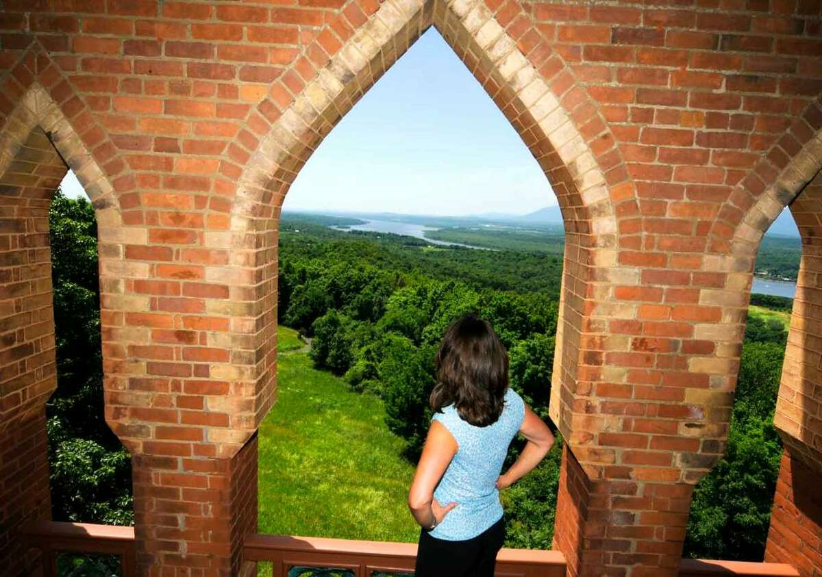 Olana curator Evelyn Trebilcock looks out over the Hudson River from the bell tower of the historic home of Hudson River School painter Frederic Edwin Church in Hudson. ( Michael P. Farrell / Times Union )
