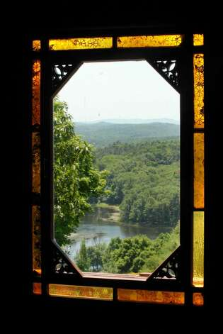 A view of a pond on the Olana grounds through the master bedroom windows. The historic home of Hudson River School painter Frederic Edwin Church is in Hudson. ( Michael P. Farrell / Times Union ) Photo: MICHAEL P. FARRELL / 00008983A