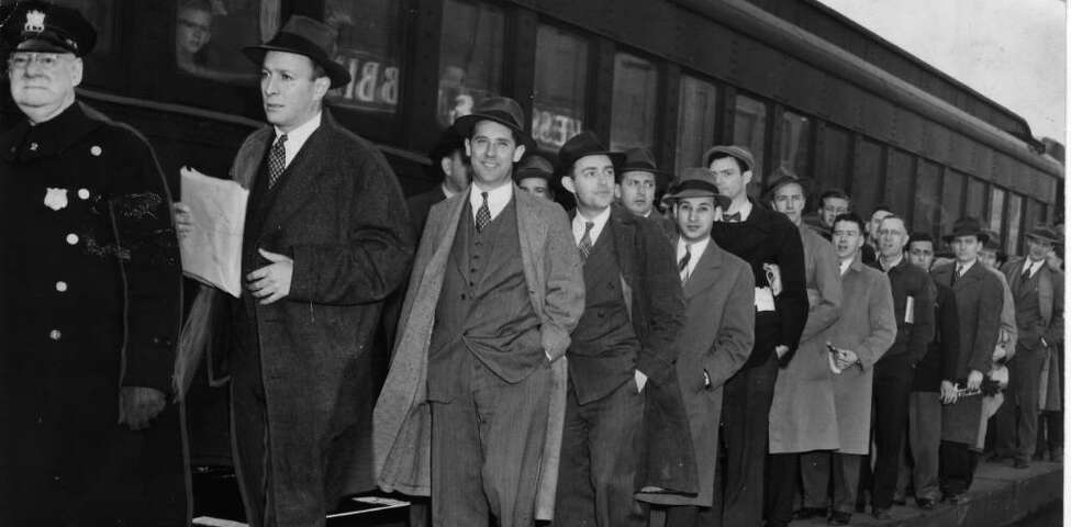 On April 13, 1944, Albany Mayor Erastus Corning 2nd leads the line to register for the draft. (Times Union Archive)