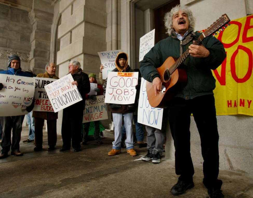 Joe Lombardo of Delmar sings during the annual People's State of the State at the Capitol in Albany, N.Y., on Tuesday. (AP Photo/Mike Groll)