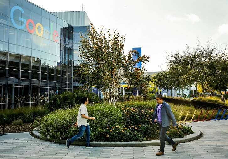 People walk through the Google campus in Mountain View, Calif., on Monday, Nov. 27, 2017.
