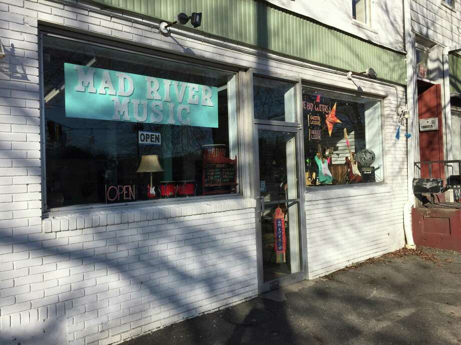 Colebrook residents Frank and Sam Guglielmino recently opened Mad River Music on Main Street in Winsted. Photo: Ben Lambert / Hearst Connecticut Media