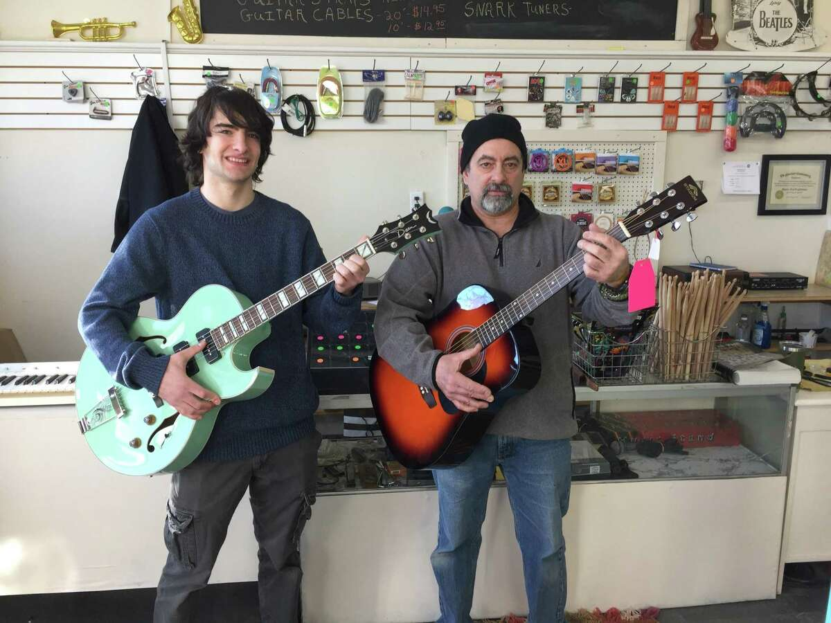 Colebrook father and son duo Frank Guglielmino, right, and Sam Guglielmino recently opened Mad River Music on Main Street in Winsted.