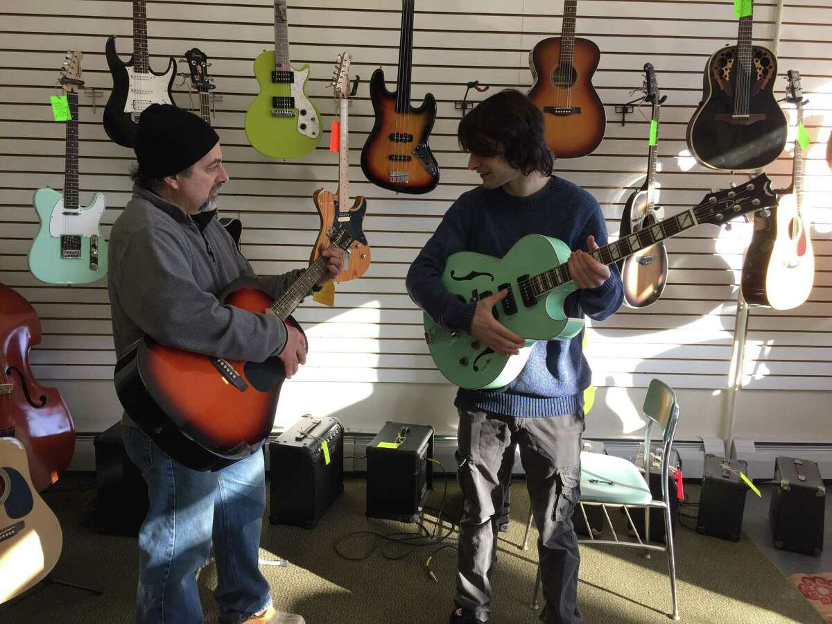 Colebrook residents Frank Guglielmino, left, and his son Sam Guglielmino recently opened Mad River Music on Main Street in Winsted.
