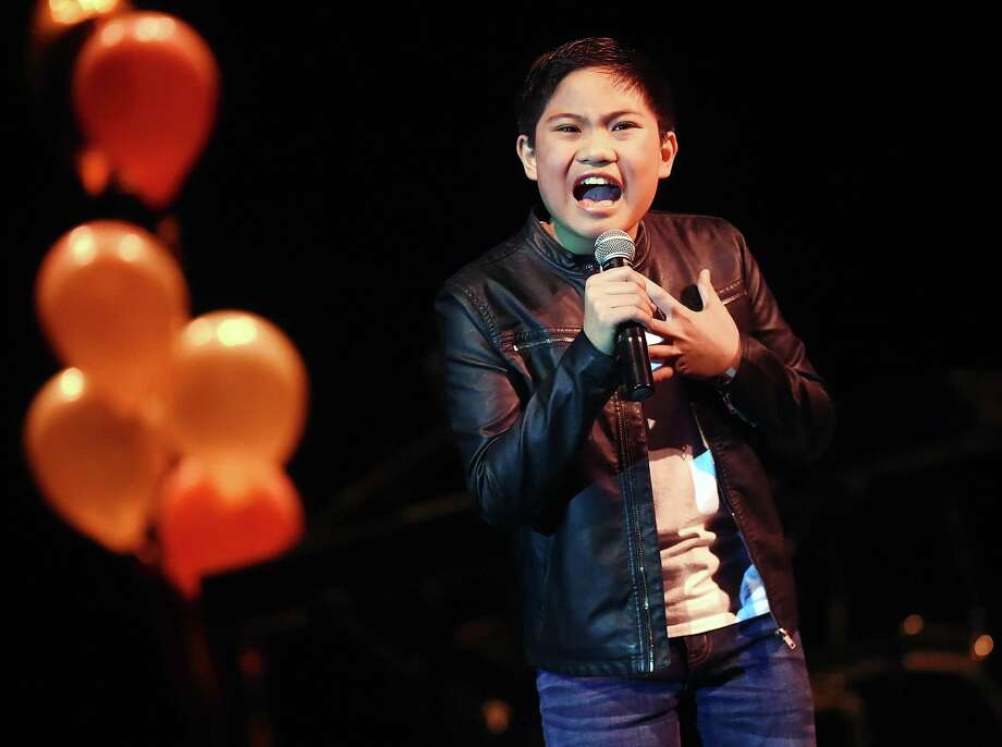 "Winner of the junior competition, Lance Matthew Mendoza, a sixth grader at Bear Path School performs ""When We Were Young"" by Adele at the Voice of Hamden, where 10 local vocalists were judged by Linedy Genao, Stacie Morgain Lewis and T. Sean Maher Thursday at the auditorium at Hamden High School. Director of Fine Arts at the Hamden Public Schools, Eric Nyquist served as master of ceremonies. A special performance by Hamden's Blessing Offor, a singer, songwriter, musician and a contestant on season seven of NBCs The Voice. The Hamden Education Foundation event, sponsored by the Law Office of Jack O'Donnell and all proceeds from the concert will benefit the Hamden public schools. Photo: Catherine Avalone / Hearst Connecticut Media / New Haven Register"