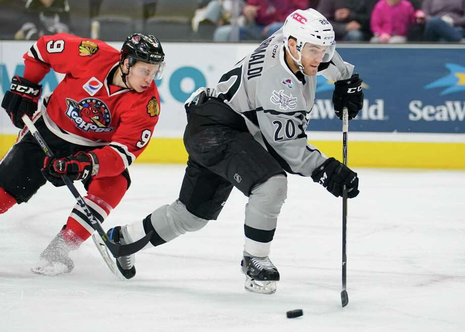 San Antonio Rampage right wing right wing Rocco Grimaldi takes control of the puck ahead of Rockford IceHogs left wing Matthew Highmore during the first period of an AHL hockey game, Sunday, Dec. 17, 2017, in San Antonio, Texas. (Darren Abate/AHL) Photo: Darren Abate, STF / AHL / Darren Abate Media, LLC