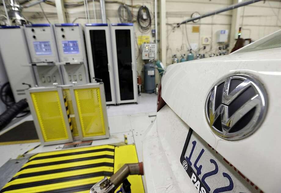A 2013 Volkswagen Passat diesel gets evaluated. Photo: Nick Ut, Associated Press