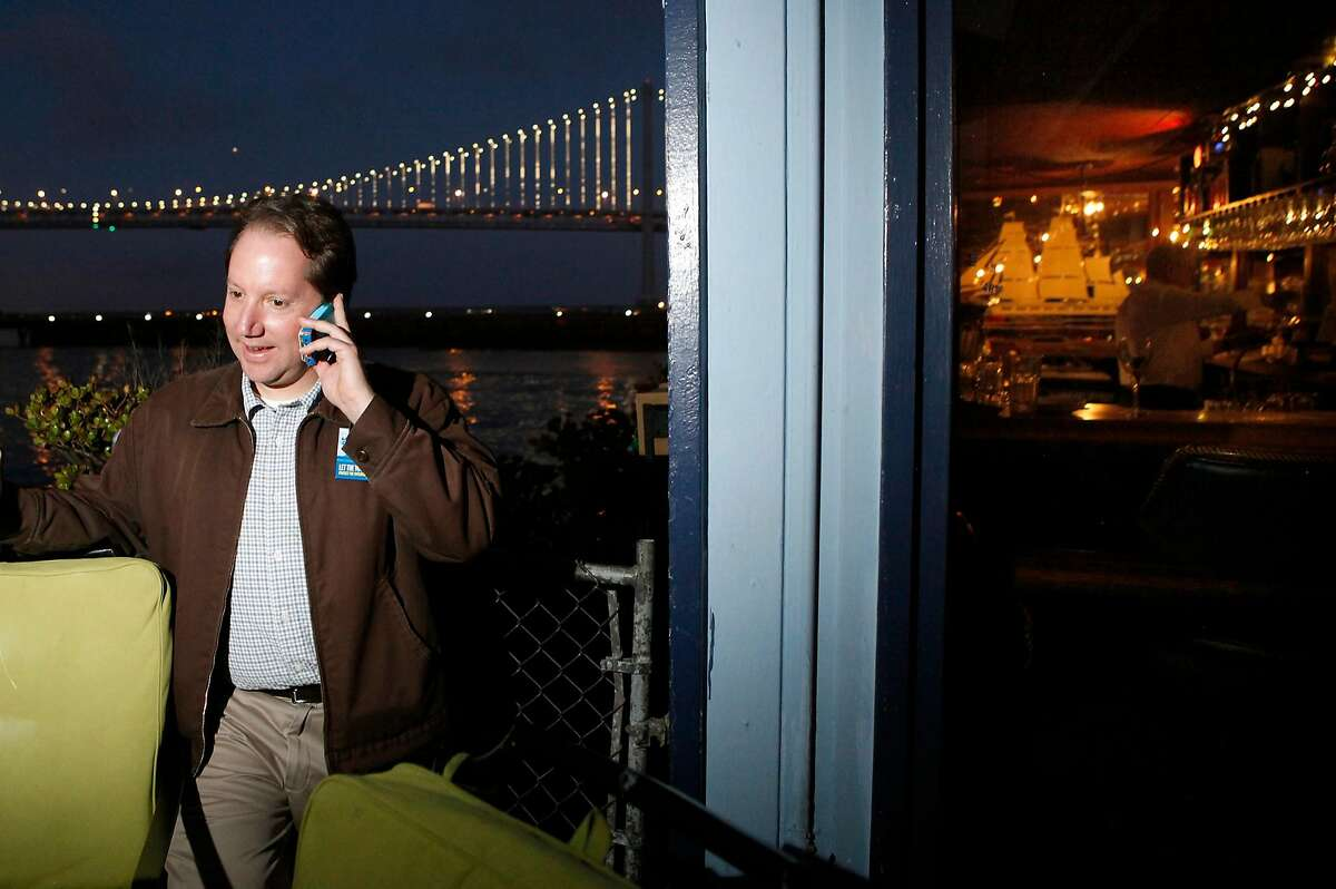 Yes on Prop. B Campaign Manager Jon Golinger takes a phone call as supporters gather for a party at Sinbad's Restaurant on Pier 2 in San Francisco, CA, Tuesday June 3, 2014.