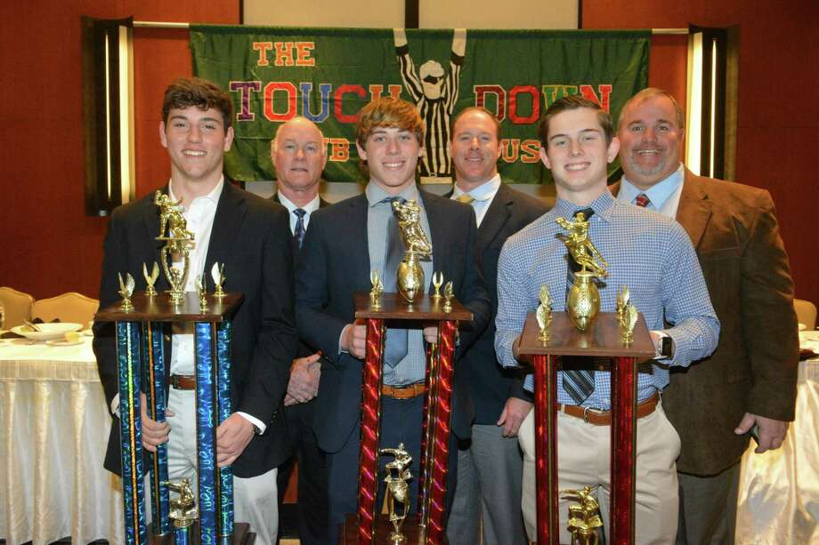 The Touchdown Club of Houston hosted its annual luncheon to recognized sportsmanship from Houston area high school football teams Jan. 24. Pictured with first-place trophies in their divisions are, from left, St. John's player Brock Cannon and coach Steve Gleaves; Klein Collins player Jackson Loftin and coach Drew Svoboda; and player Jonathan Dullen and coach Jim Holley from Porter. Photo: Touchdown Club Of Houston