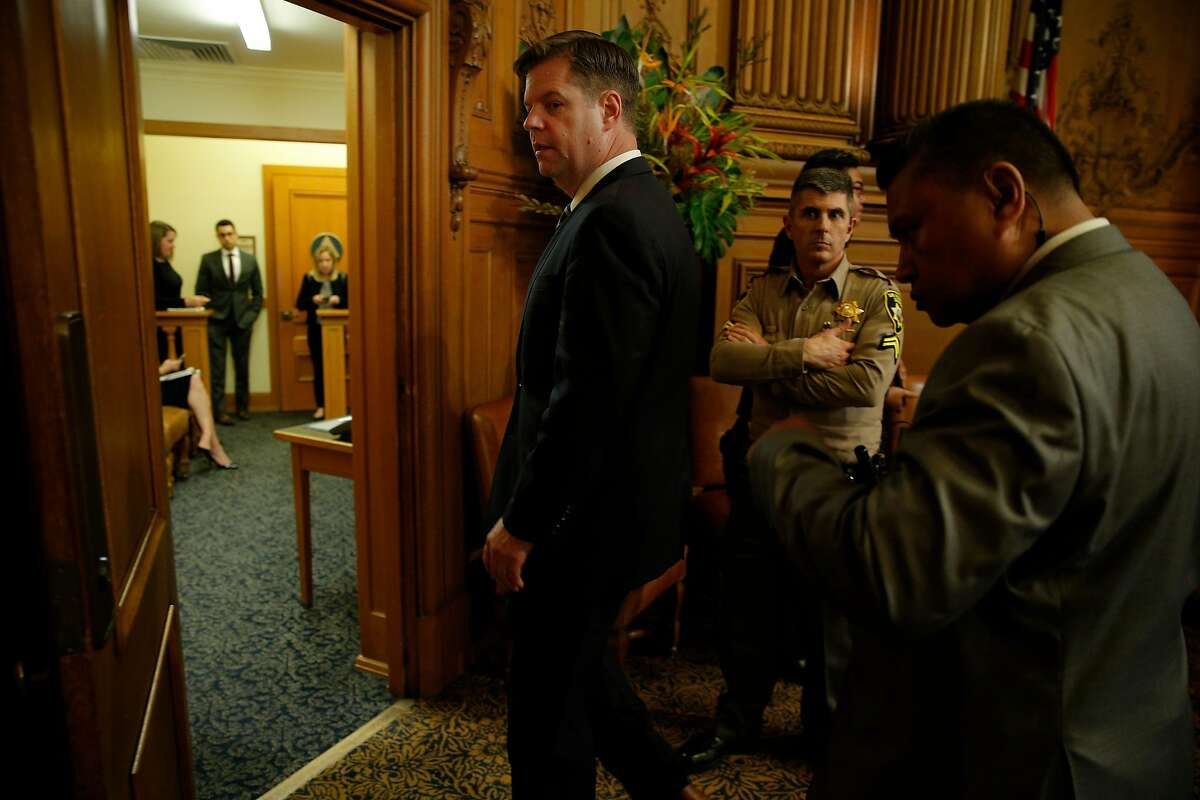 Supervisor Mark Farrell exits the board of supervisors meeting at City Hall after being voted interim mayor by the supervisors, Tuesday, Jan. 23, 2018, in San Francisco, Calif.