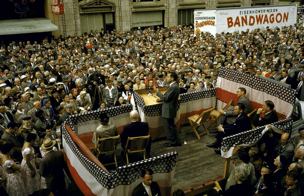 Vice President Richard Nixon speaking to a large crowd assembled in Oakland for a rally during the 1956 presidential campaign.