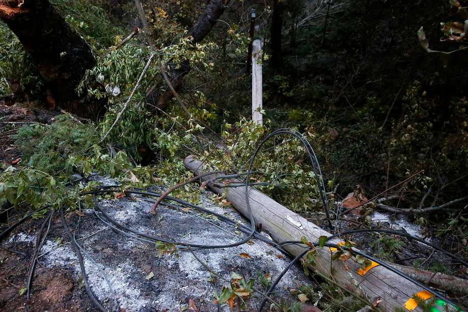 A power pole lies along Nuns Canyon Road in the Sonoma County community of Glen Ellen on Oct. 17 after the Wine Country fires devastated the North Bay. On the first night of the fires, Sonoma County dispatchers contacted PG&E about troubles with gas and electrical lines in at least 54 locations. Photo: Michael Macor, The Chronicle