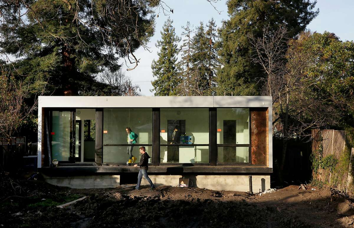 The extra house in Google design director Joshua To's backyard is made from four shipping containers.