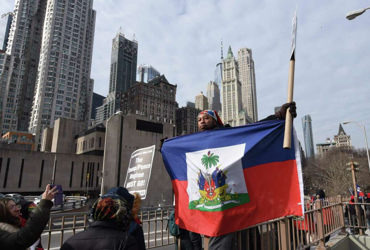 Responding to the alleged racist comments from President Trump, immigrants - including members of the Haitian community - march across the Brooklyn Bridge to a rally at a Trump property in Manhattan. A reader speaks glowingly of the education he received in Haiti.