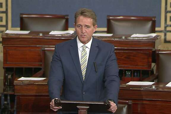 Sen. Jeff Flake, R-Ariz., takes to the Senate floor on Jan. 17 to call the president's repeated attacks on the media shameful and repulsive, and compare him to a despot. But he's more like that angry guy at the end of the bar.