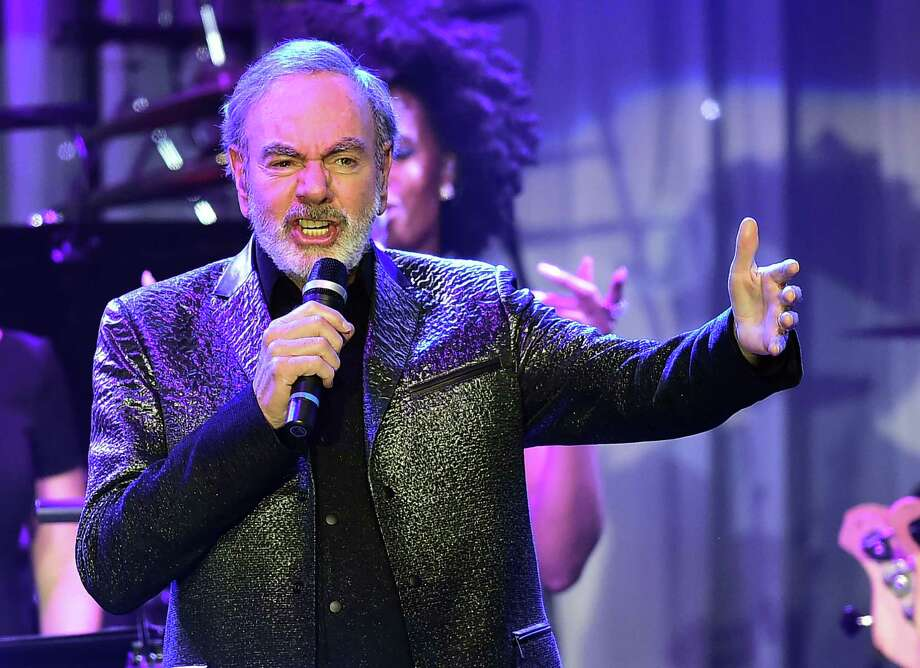 Complete, unfiltered happiness — that's what Neil Diamond offered, no matter how uncool the other kids thought him. Photo: Frederic J. Brown /Getty Images / AFP or licensors