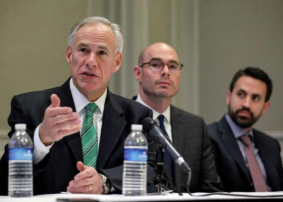 Gov. Greg Abbott, from left, state Rep. Dennis Bonnen and David Garcia, a Harris County homeowner, during a press conference about a new property tax proposal, at the Westin Galleria hotel Jan. 16 in Houston. Photo: Jon Shapley /Houston Chronicle / © 2017 Houston Chronicle