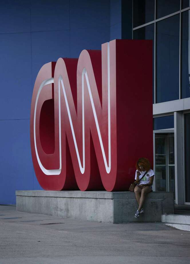 A pedestrian sits at CNN headquarters in Atlanta. Flip between CNN and Fox News and you'll see broadcasts that have become more partisan. Photo: Michael A. Schwarz /Bloomberg / © 2014 Bloomberg Finance LP