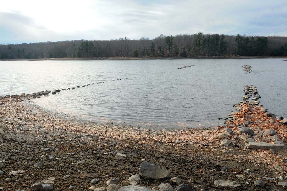 Low water levels in Easton Reservoir reveal stone walls that once lined roads and farms before the land was flooded in 1926, seen here from Trumbull, Conn. Dec. 6, 2017.