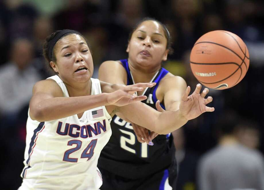 UConn's Napheesa Collier (24) steals a pass intended for Tulsa's Rebecca Lescay (21) at Gampel Pavilion in Storrs on Jan. 18. Collier needs six more steals to join Maya Moore and Breanna Stewart as the only players in UConn history with at least 150 career steals and blocked shots. Photo: Brad Horrigan / TNS / Hartford Courant