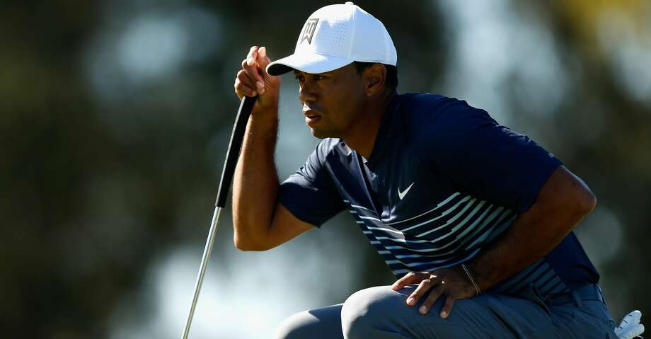 SAN DIEGO, CA - JANUARY 26:  Tiger Woods looks over a putt on the 13th green during the second round of the Farmers Insurance Open at Torrey Pines North on January 26, 2018 in San Diego, California.  (Photo by Michael Reaves/Getty Images) Photo: Michael Reaves/Getty Images