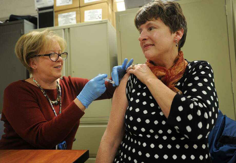 Public Health Nurse Kathy Malski, RN, gives a flu shot to Peggy Jo Thomas, of Morris, during a free flu shot clinic at Milford Health Department offices in Milford, Conn. on Wednesday, January 24, 2018. Photo: Brian A. Pounds / Hearst Connecticut Media / Connecticut Post