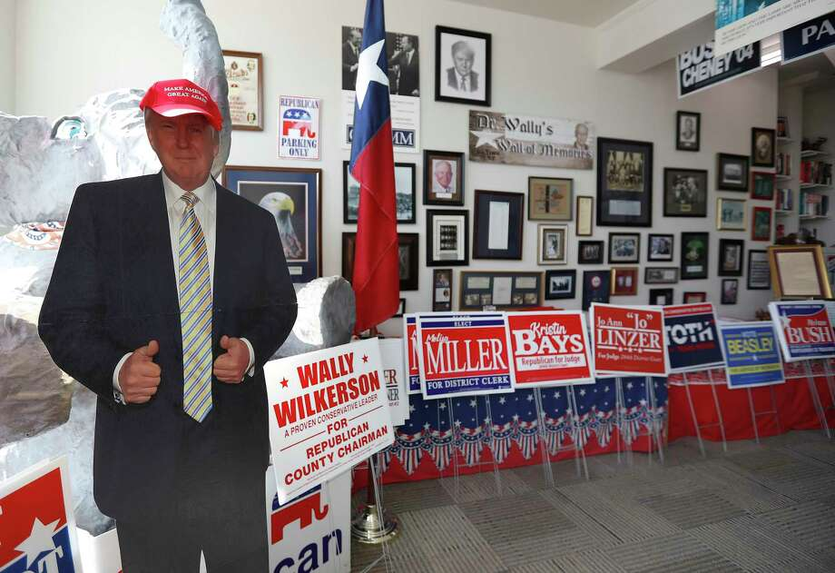 A cardboard cutout of Donald Trump inside of the Montgomery County Republican Party headquarters, along with various yard signs for republicans running for office in Montgomery County, Thursday, Jan. 25, 2018, in Conroe. A look at what Trump voters in Montgomery County   think of Trump a year into his presidency. Photo: Karen Warren, Houston Chronicle / © 2018 Houston Chronicle