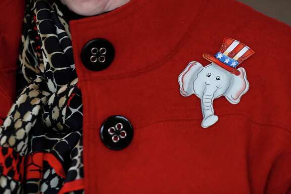 A woman wears an elephant pin while attending the Montgomery County Republican Women's meeting at the River Plantation Country Club, Thursday, Jan. 25, 2018, in Conroe. A look at what Trump voters in Montgomery County   think of Trump a year into his presidency.