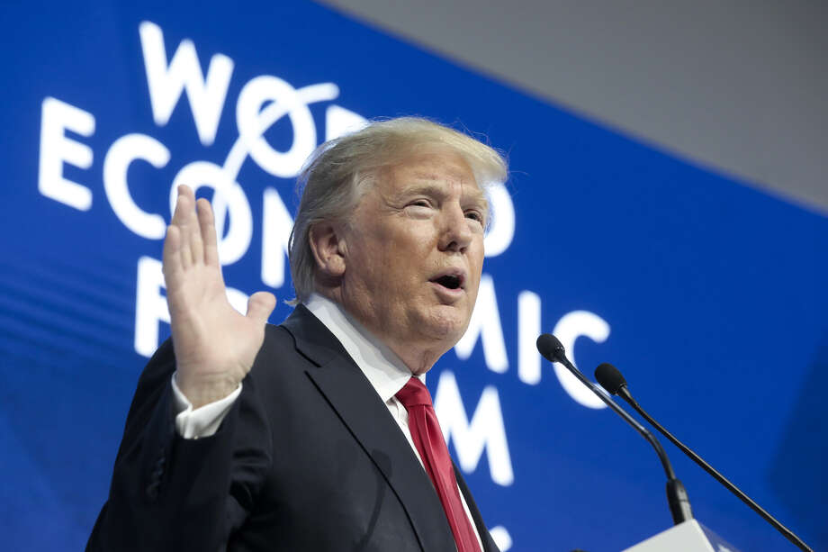 """President Donald Trump, at the World Economic Forum in Davos, Switzerland, wooed businesses, got booed over a """"fake news"""" remark, and tried to mend fences with an African leader. Photo: Jason Alden / © 2018 Bloomberg Finance LP"""