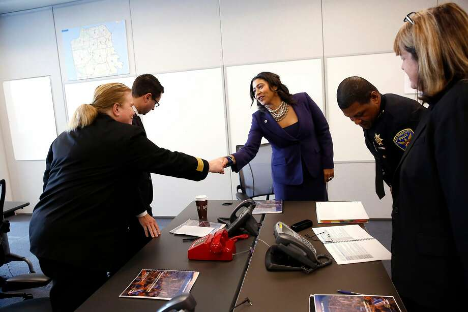 Then-acting Mayor London Breed greets Fire Chief Joanne Hayes-White during a briefing with city officials updating her on the city's emergency preparedness and protocol in December. Photo: Michael Macor, The Chronicle